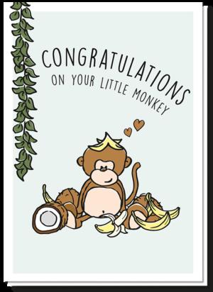 Voorkant geboortekaart met daarop een liaan en een aapje dat zit tussen de bananen en kokosnoten met de tekst 'Congratulations on your little monkey'