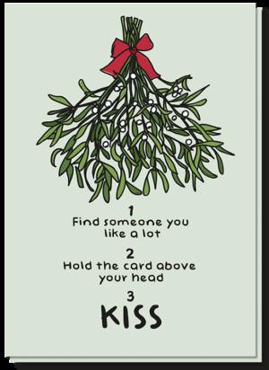Lieve kerstwensen met een mistletoe kerstkaart. Houdt de mistletoe kaart boven je hoofd en kus degene die naast je staat