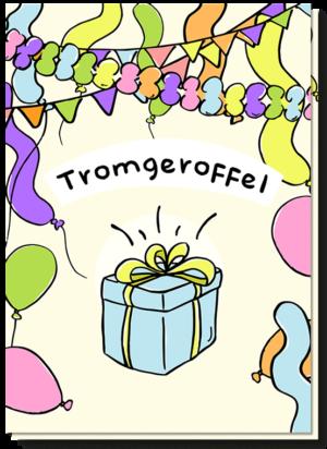 Voorkant verjaardagskaart met daarop veel slingers, ballonen en een cadeautje